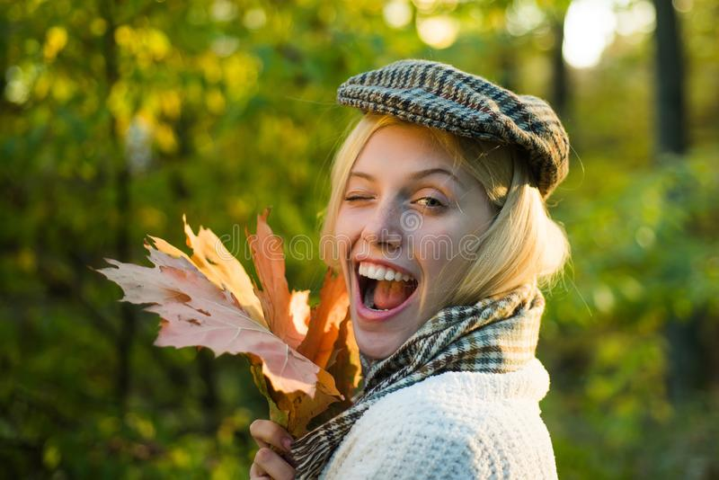 Happy autumn girl winking - close up portrait. Autumn outdoor portrait of beautiful happy girl walking in park or forest royalty free stock photos