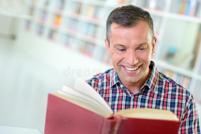 Happy and avid reader. Man stock images