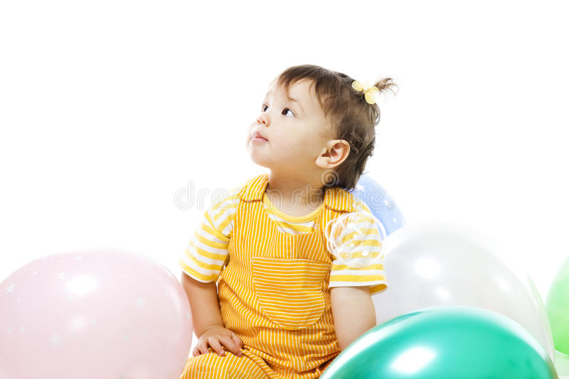 Happy baby with baloons on her first birthday. Isolated on white royalty free stock image