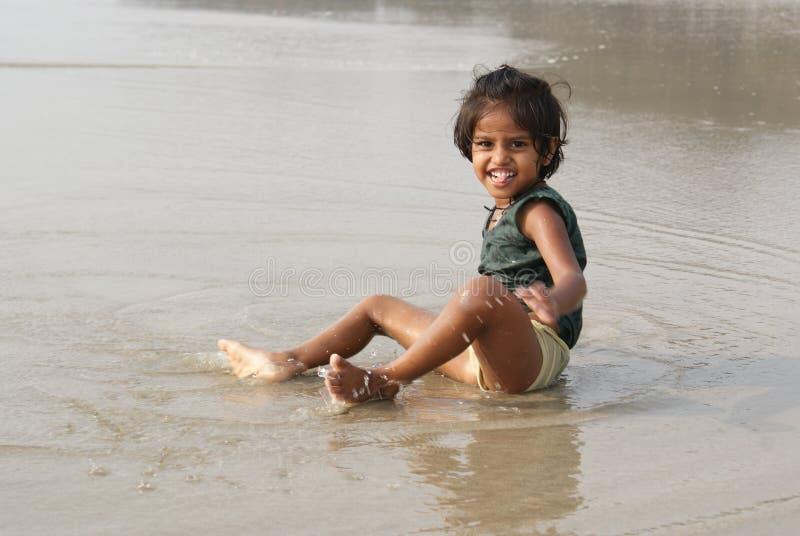 Happy baby on beach royalty free stock photography