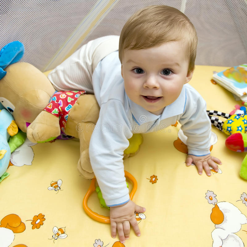 Happy baby on bed royalty free stock photo