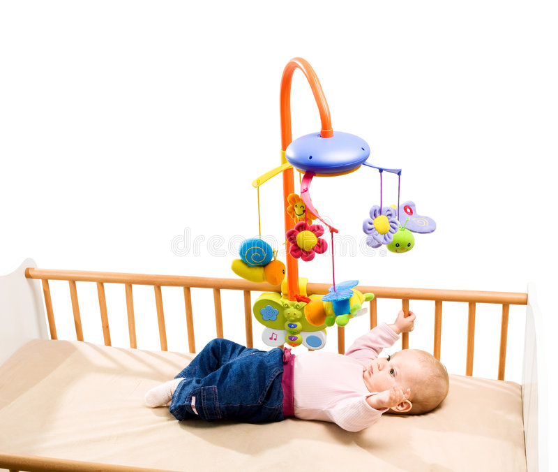 Happy baby in bed royalty free stock images