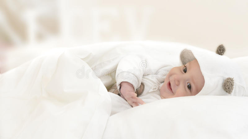 Happy Baby in Bed stock photo