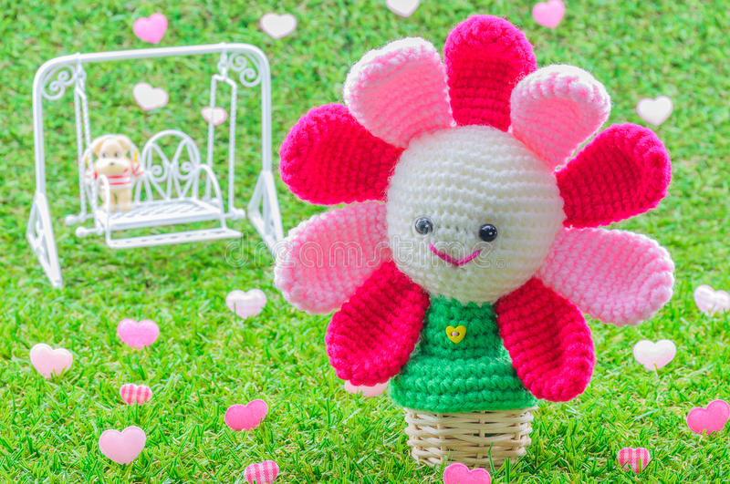 Happy baby blooming flower crochet doll royalty free stock image
