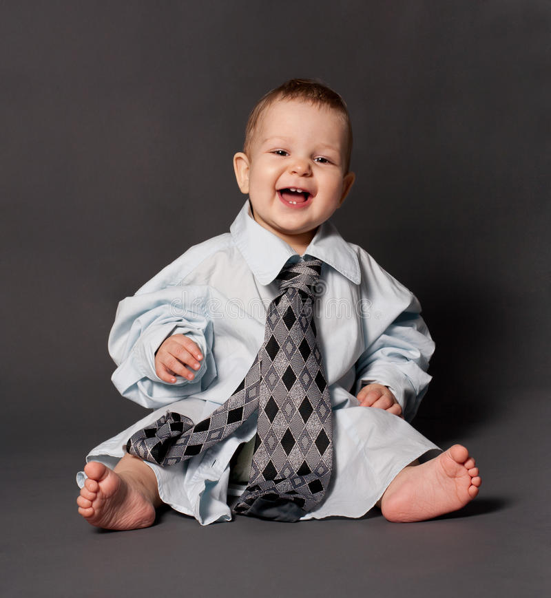 Happy baby boss wearing over sized suit