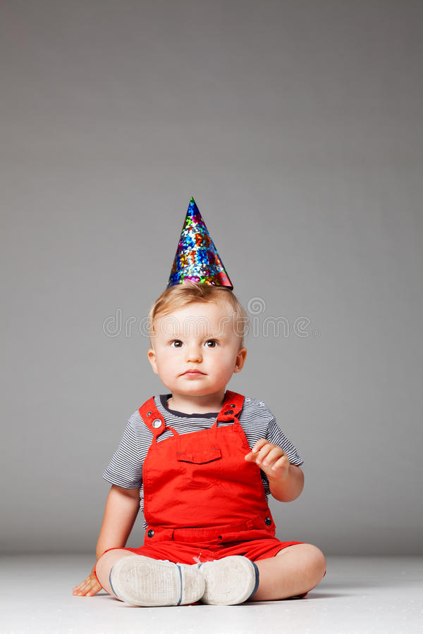 Baby birthday boy with hat royalty free stock photography