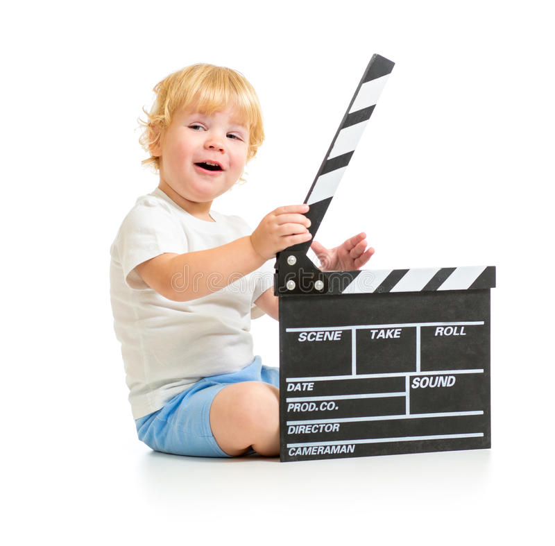 Happy baby boy with clapper board sitting on floor royalty free stock images