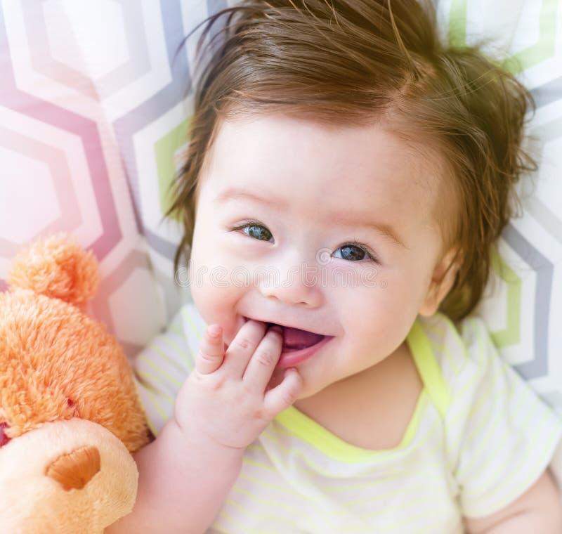 Happy baby boy with his teddy bear royalty free stock photo