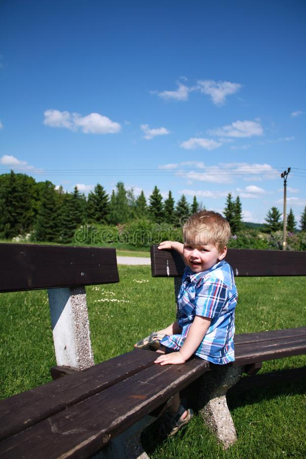 Happy baby boy outside stock photos