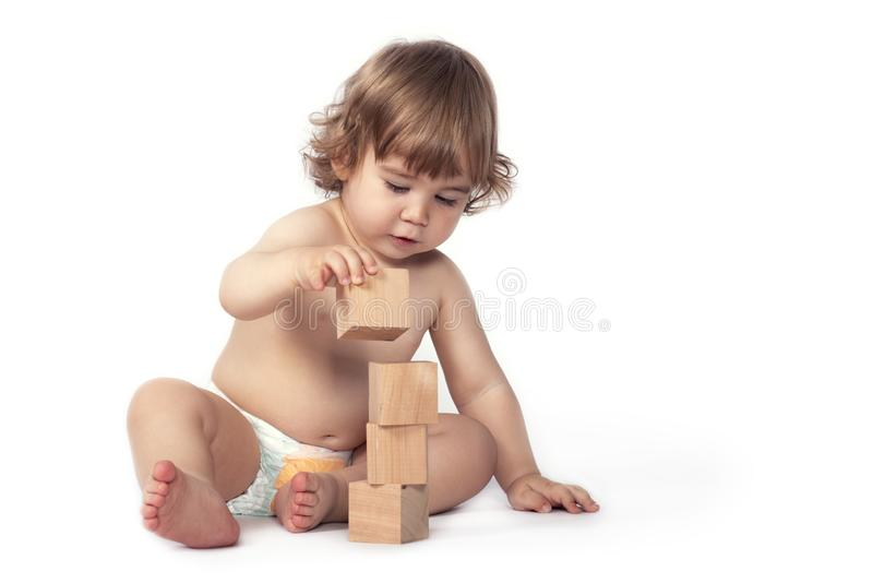 Happy Baby Boy Playing with Toys, Isolated on White royalty free stock image
