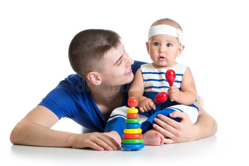 Happy baby and dad play together stock images