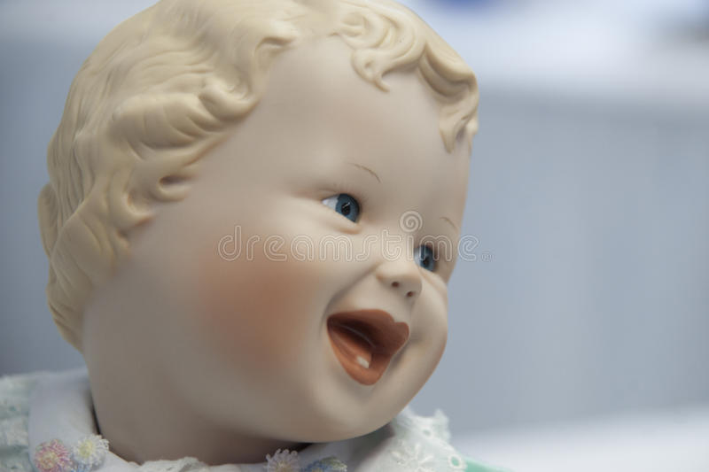 Happy Baby Doll stock images
