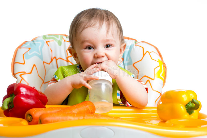 Happy baby drinking from bottle royalty free stock photos