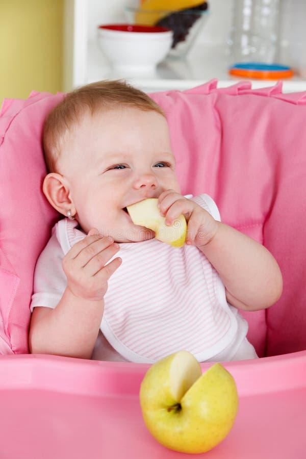 Free Happy Baby Eating Apple Royalty Free Stock Photo - 49776985
