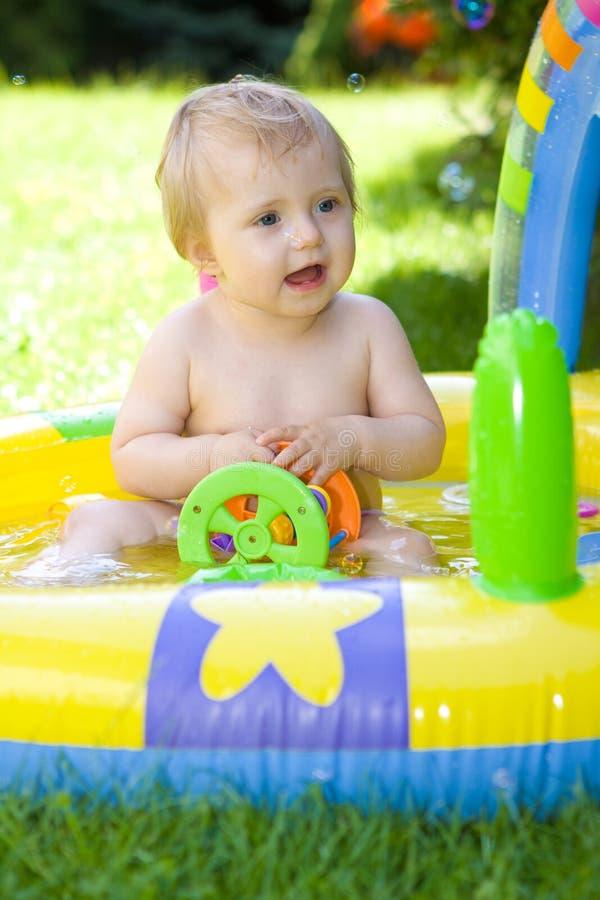 Happy baby in garden. Sweet baby girl in garden royalty free stock image