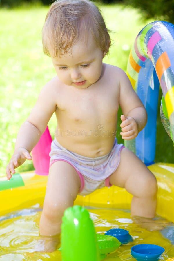 Happy baby in garden. Sweet baby girl in garden stock photos