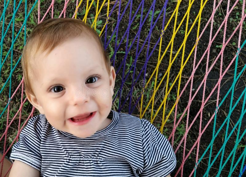 Happy baby. An happy baby in the garden stock photo