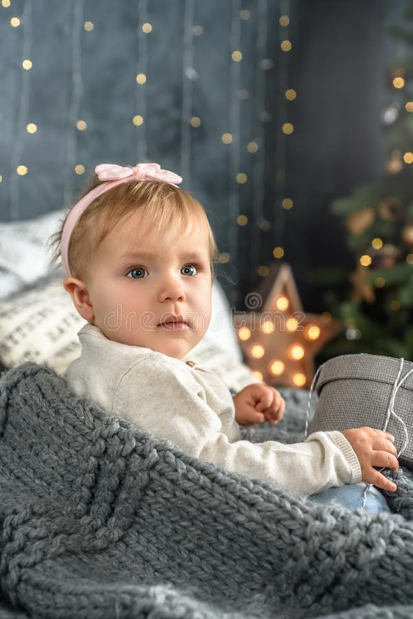 Happy baby girl under the Christmas tree home stock images