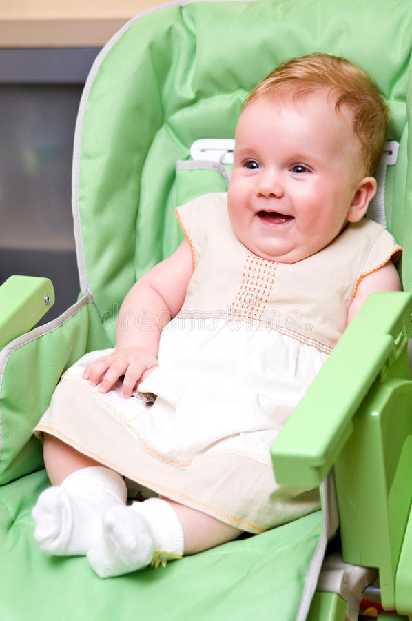 Download Happy baby in high chair stock image. Image of fastened - 15728277