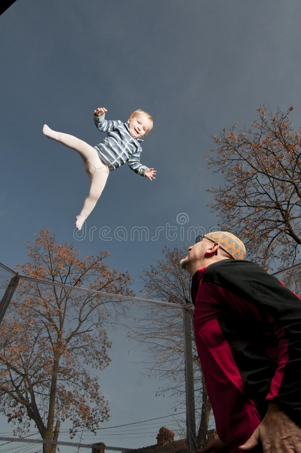 Download Happy Baby Jumping Up On Trampoline Stock Photo - Image: 22393384