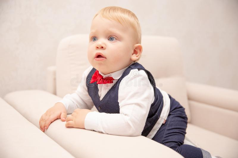 Happy baby. Little boy in a white shirt and bow tie. Children portrait. Stylish man in fashionable a bow-tie. royalty free stock photos