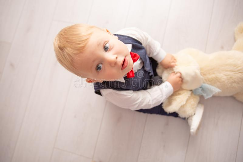 Happy baby. Little boy in a white shirt and bow tie. Children portrait. Stylish man in fashionable a bow-tie. Happy baby. Little boy one year old in a white royalty free stock images