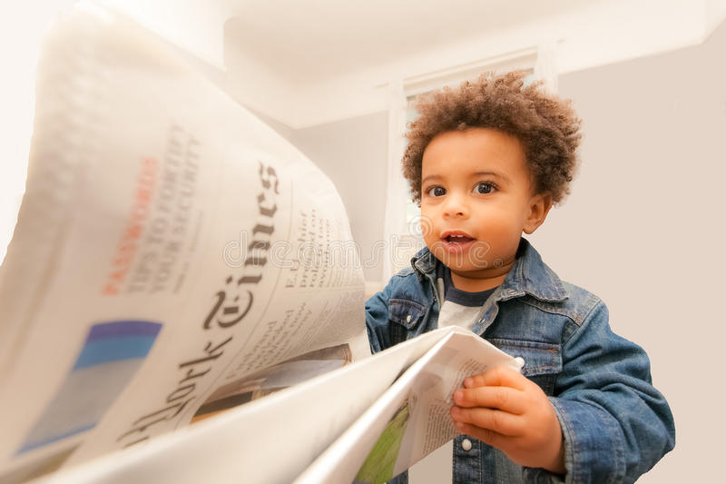 Baby Reads New York Times royalty free stock photography
