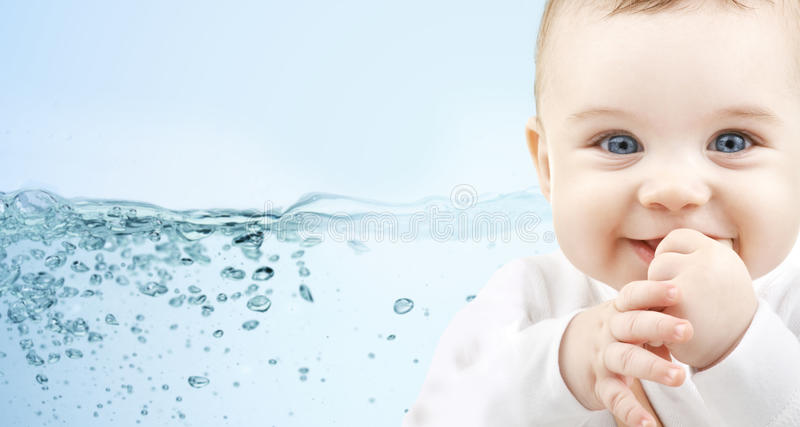 Happy baby over blue background with water splash royalty free stock image