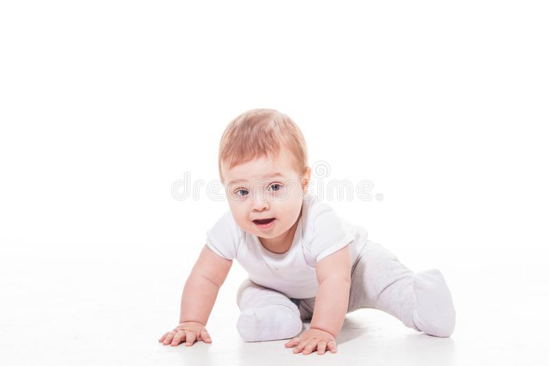 Happy baby is playing on the floor stock image