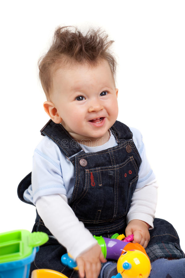 Happy baby playing with toys stock image