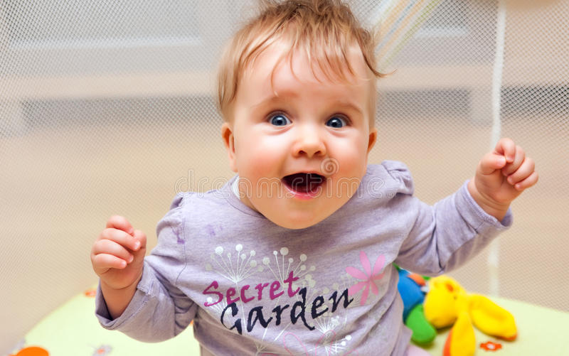 Happy Baby In Playpen Royalty Free Stock Images