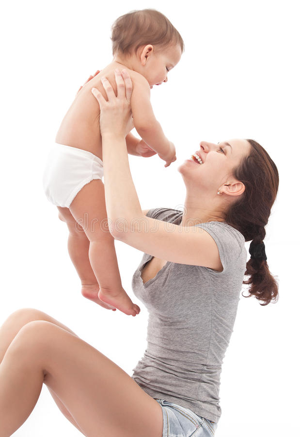 Happy baby plays with mother. royalty free stock images