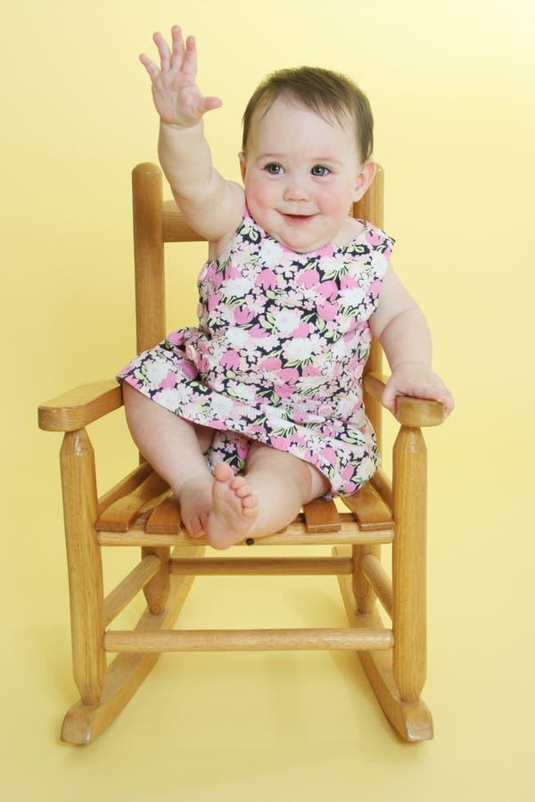 Happy baby raising hand royalty free stock image