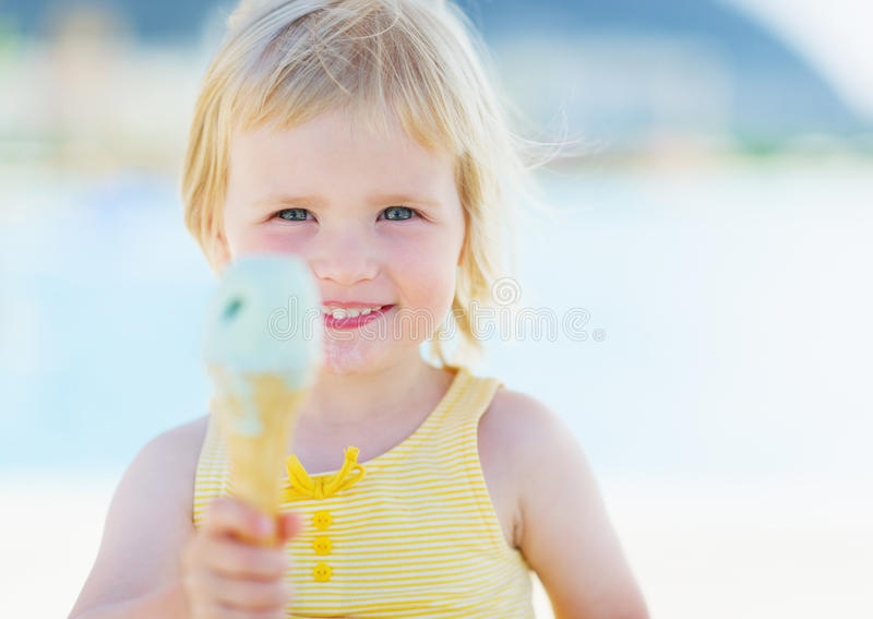 Happy baby showing ice cream royalty free stock photography