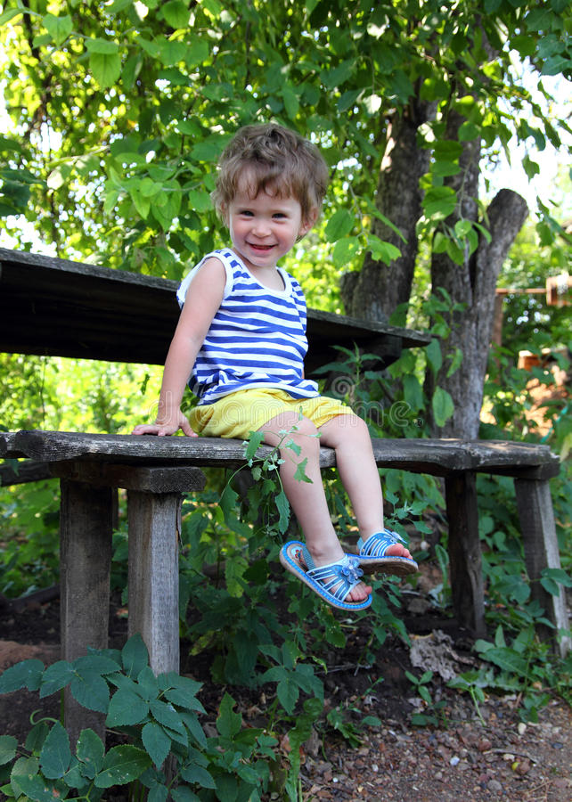Download Happy Baby Sitting In Garden Stock Photo - Image of park, child: 16828184