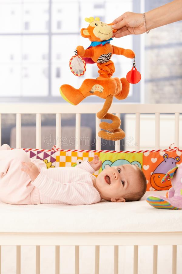 Happy baby with toy royalty free stock photography