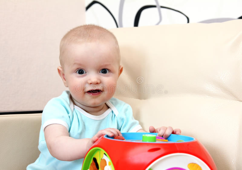 Download Happy Baby With Toy Stock Photos - Image: 25220873