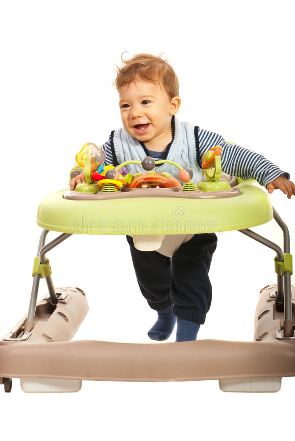 Happy baby in walker royalty free stock photography