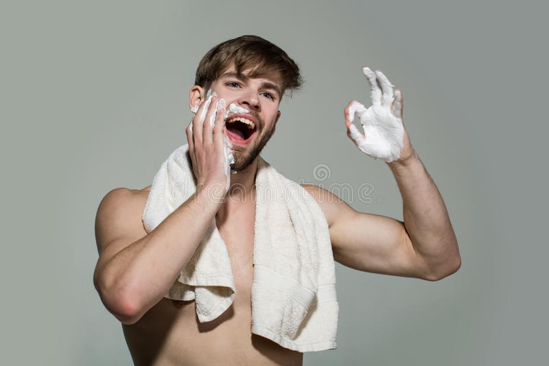 Happy bachelor with shaving cream on face show ok stock photos