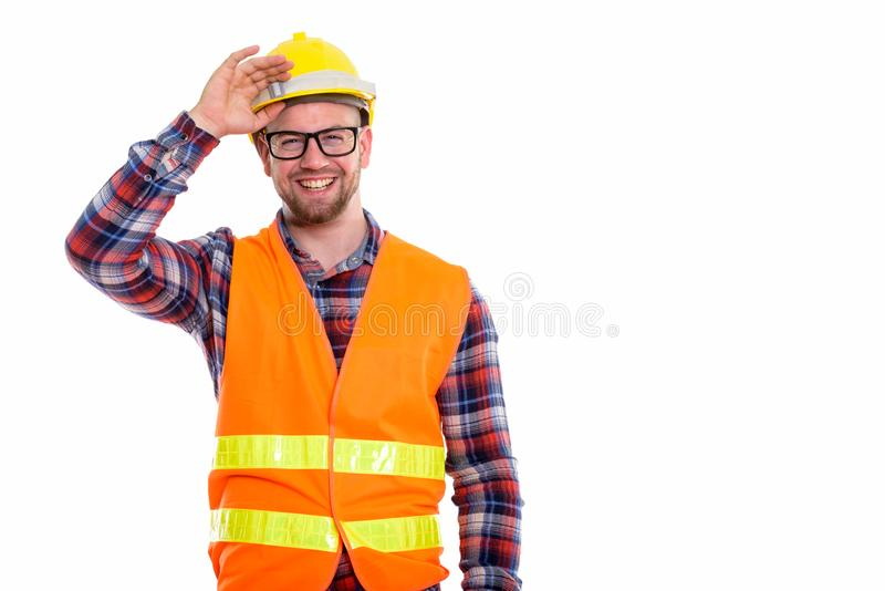 Young bald muscular man construction worker royalty free stock photo