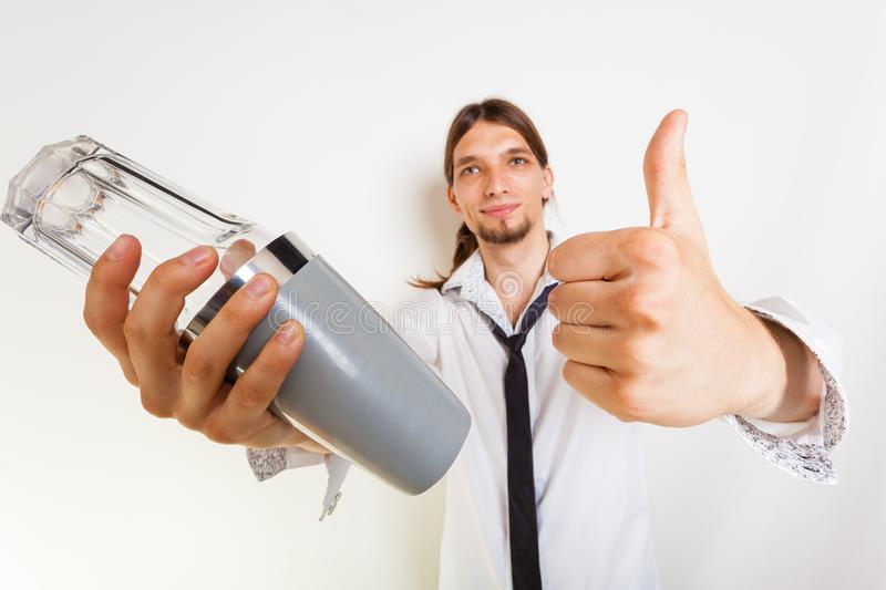 Happy bartender makes gesture. Bartending celebration party relax alcohol liquor concept. Happy bartender makes gesture. Young male holding glass shaker showing stock images