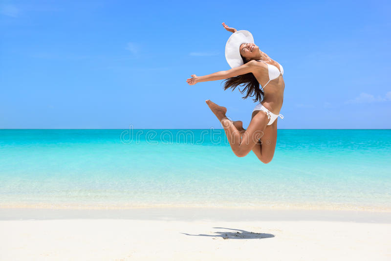 Happy beach woman jumping of weight loss success stock images