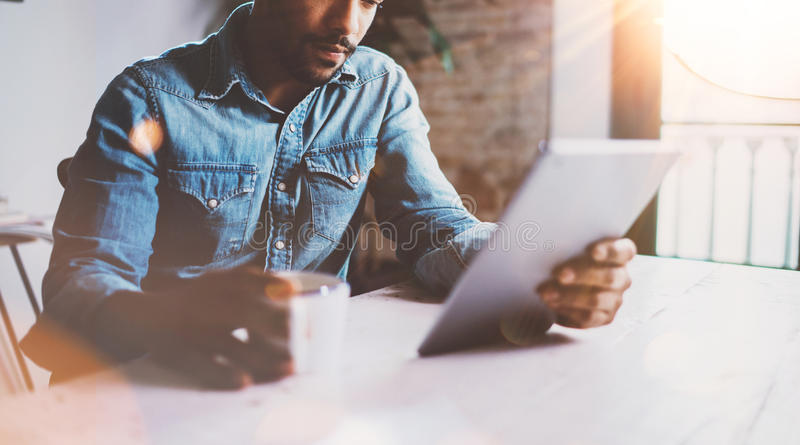 Happy bearded African man making video conversation via digital tablet with partners while working at home.Concept of stock photos