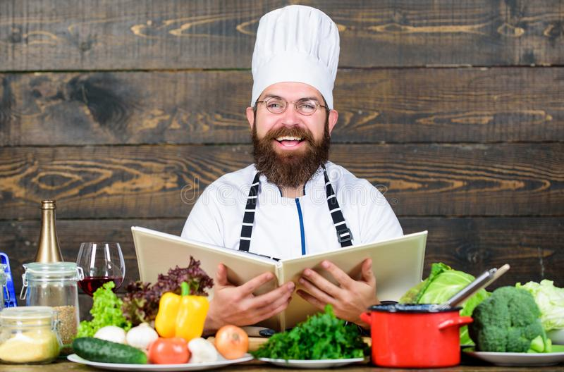 Happy bearded man. chef recipe. Cuisine culinary. Vitamin. Healthy food cooking. Mature hipster with beard. Dieting. Organic food. Vegetarian salad with fresh stock image
