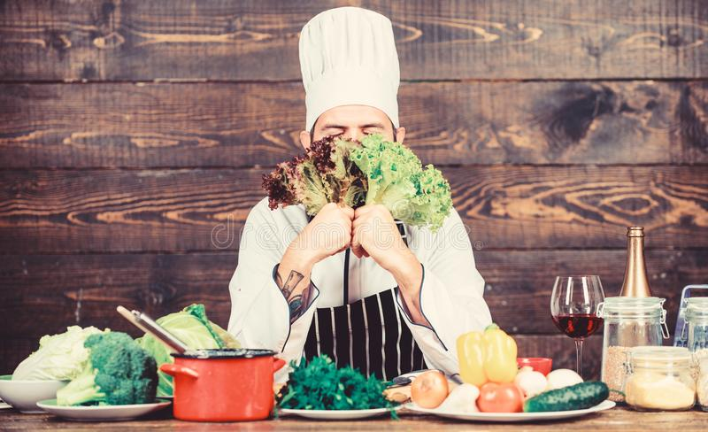 Happy bearded man. chef recipe. Cuisine culinary. Vitamin. Healthy food cooking. Mature hipster with beard. Dieting. Organic food. Vegetarian salad with fresh royalty free stock photos