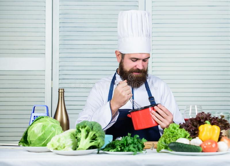 Happy bearded man. chef recipe. Dieting organic food. Vegetarian salad with vegetables. Cuisine culinary. Vitamin royalty free stock images
