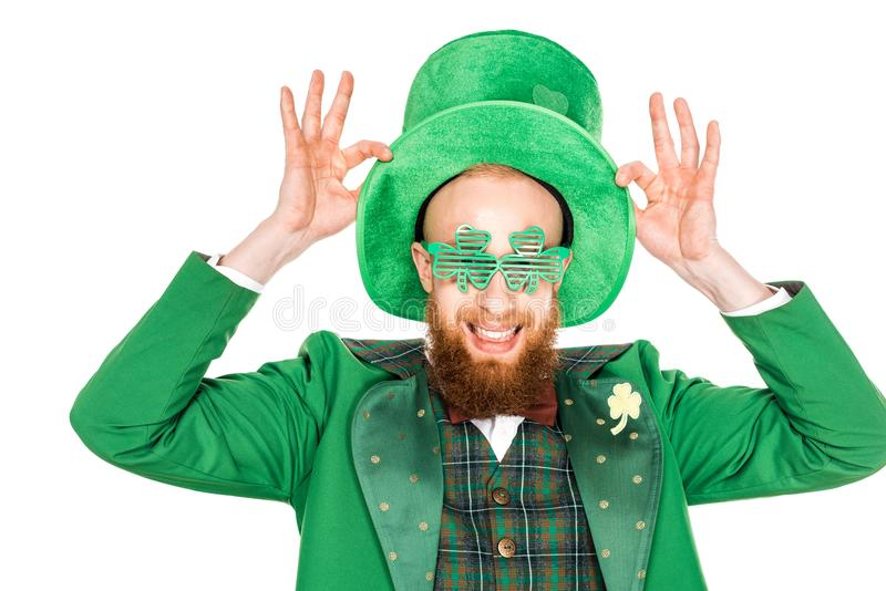 Happy bearded man in green costume and hat smiling stock images