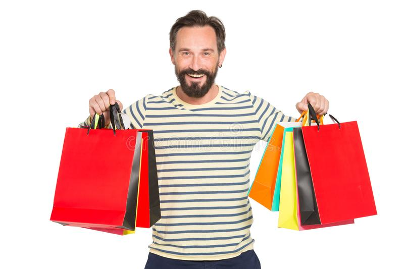 Happy bearded man holding up colorful shopping bags. Christmas and holidays concept. happy and smiled man holding lot of bags stock image