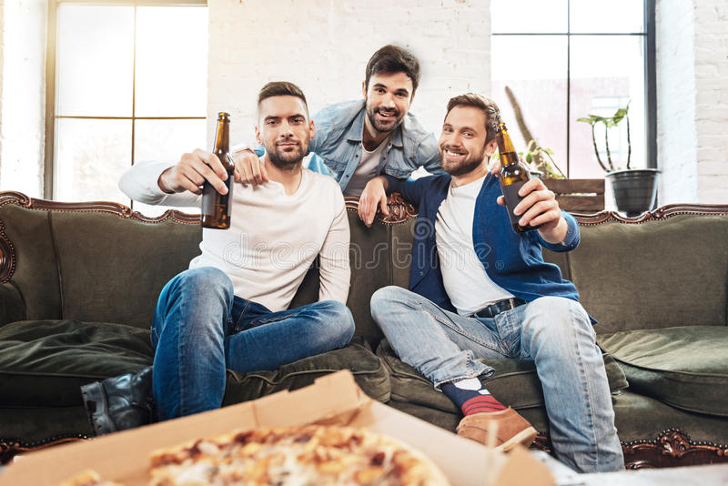Happy bearded man hugging his friends stock photo