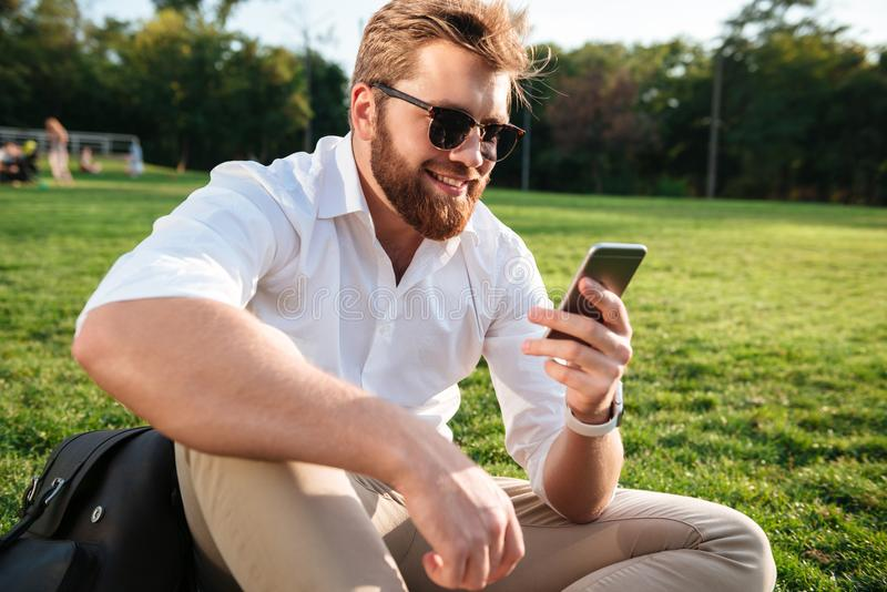 Happy bearded man in sunglasses and business clothes stock images